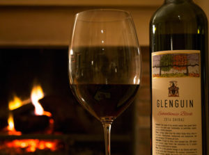 Schoolhouse Block Shiraz by an open fireplace